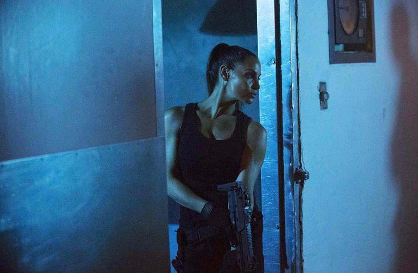 Trish Stratus as Gina in <i>Gridlocked</i>