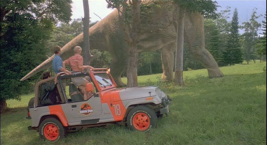 Few scenes from Spielberg's dino classic are as memorable, few baddie deaths come as perfectly executed as rogue security programmer Dennis Nedry's death by blinding, then mauling at the claws of the at once cute, at once deadly Dilophosaurus. The car he's in at the time? The venerable Jeep TJ, complete with winch kit, spotlights, bright red wheels and Jurassic Park branding. It wasn't enough to get poor Mr. Nedry to the dock, but it will stick in the minds of <i>Jurassic</i> enthusiasts for a long time.