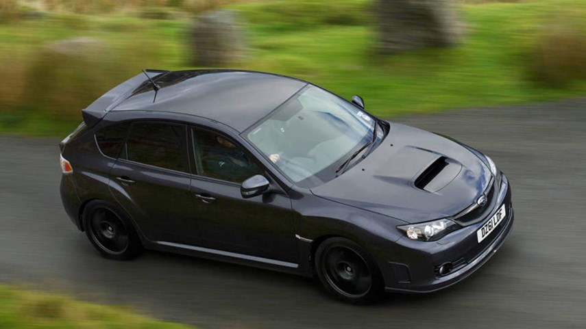 The interior was now a more grown-up mix of dark Alcantara and minimal accents, and everything felt more substantial. The exterior, though, that was still proper STI, with huge flares to cover the wide BBS wheels.
