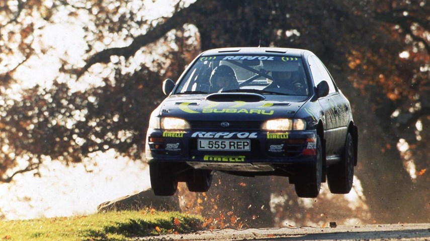 As far as fans of the STI are concerned, the story begins with Colin McRae, air-borne over a hump in the road and streaming gravel out behind him like a comet. The triple-5 car would be both hero car and forbidden fruit to Canadian rally fans. Prepared by racing specialists Prodrive, this 300 hp Group A rally car thrilled audiences. Scottish driver McRae was perhaps less precise than his Finnish rivals, but his seat-of-the-pants style earned him a huge fanbase.