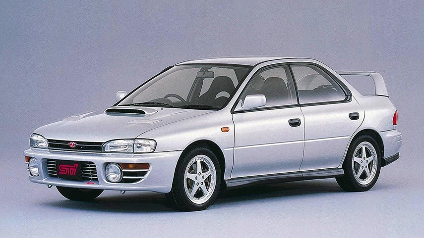 The very first STI models were created by pulling existing WRXs off the assembly line and strengthening their mechanicals. Special, hardcore models of the WRX had existed right from 1992, but the first proper STIs had further upgrades. Version 1 cars saw front strut tower bars made of carbonfibre, forged pistons, and better intercooling. The 2.0L flat-four powerplant made 250 hp in JDM trim, thanks to their readily available high-octane fuel.