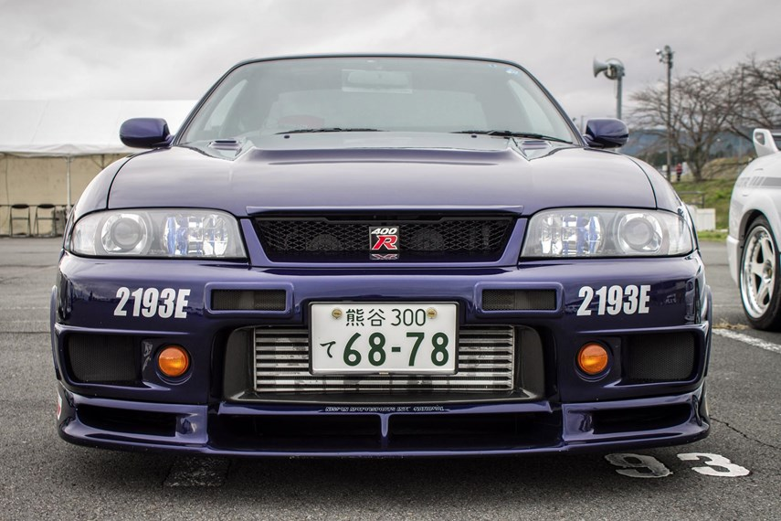 The R32 was built until 1994, and the car that replaced it was not quite as fierce at first. The R33 GT-R was a smoothing of the breed, slightly heavier, a little better equipped, and easier to drive.